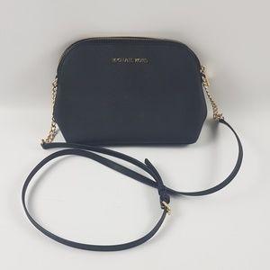 Michael Kores black cross body purse.